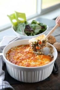 This Shepherd's Pie is a hearty and simple dinner made with ground beef and veggies in a flavorful broth topped with fluffy garlic mashed potatoes and a sprinkle of cheese. Classic comfort food for cold weather months or to celebrate St. Patrick's Day.