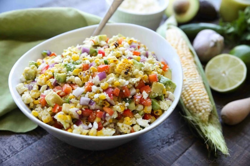 This summer Corn Salad with Queso Fresco is loaded with grilled corn, crisp onions and peppers, and creamy avocado, all topped with a homemade cilantro lime vinaigrette and generous helping of delicious queso fresco.
