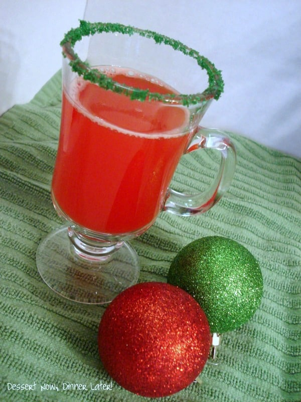 This Holiday Punch has tropical flavors, fruit juice, and club soda for a fizzy, fruity, red punch! (Lighter version also available!)