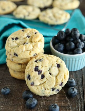 Blueberry Cheesecake Cookies are made with a muffin mix for a fruity, soft, and chewy cookie studded with creamy white chocolate chips. A quick and easy dessert!