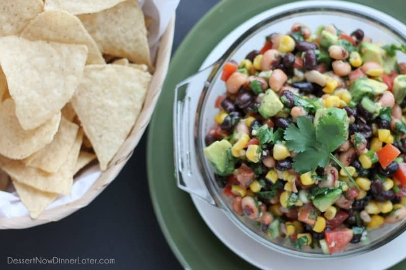 Cowboy Caviar is a chunky salsa-type dip with beans, avocado, tomatoes, corn and a zesty dressing. Great for picnics, potlucks, parties, or a game day snack!