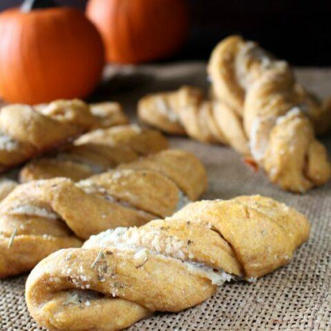 Savory Pumpkin Twists - Soft, moist yeast rolls featuring savory pumpkin flavors