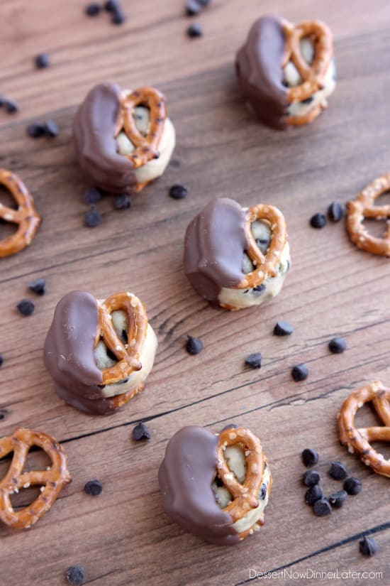 Cookie Dough Pretzel Bites - eggless chocolate chip cookie dough sandwiched between two pretzels and dipped in milk chocolate! From DessertNowDinnerLater.com