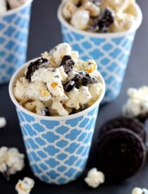 Cookies and Cream Popcorn - white chocolate and Oreos come together to flavor this air popped corn! From DessertNowDinnerLater.com