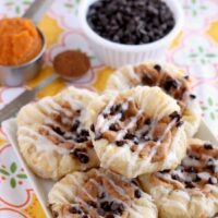 Pumpkin Chocolate Chip Pastries are made with frozen puff pastry dough, a spiced pumpkin cream cheese, and mini chocolate chips! They are especially delicious warm from the oven with a powdered sugar glaze! From DessertNowDinnerLater.com