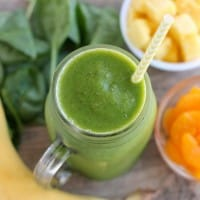This Pineapple Orange Banana Green Smoothie is fruity and refreshing with chia seeds and spinach to add fiber and protein for additional nutrition! From DessertNowDinnerLater.com
