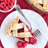 This Raspberry Pie can be made with frozen or fresh raspberries for a vibrant and delicious fruit pie! From DessertNowDinnerLater.com