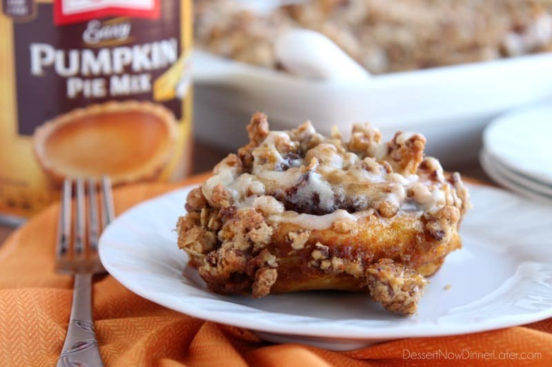 Cinnamon Pumpkin Crumble - frozen cinnamon rolls smothered in pumpkin pie mix, spices, and a crispy-crunchy streusel, then baked to perfection and served with a drizzle of cream cheese frosting and caramel!