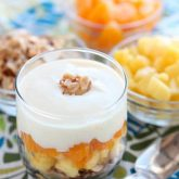 Enjoy this Dairy-Free Tropical Parfait with a homemade honey almond coconut granola base, layers of pineapple and mandarin oranges, all topped with a creamy-textured, smooth Dairy-Free Yogurt Alternative from Silk!