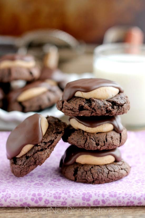 Buckeye Cookies - a chocolate brownie cookie base, topped with peanut butter balls, all covered in chocolate! These are insanely delicious!