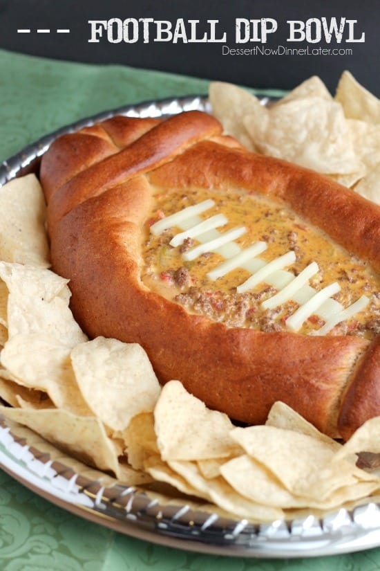 This Football Dip Bowl is made with a frozen whole wheat dough that is shaped into a football with a place to hold your favorite queso dip! Make laces with cut up string cheese and you have a football themed party food! (Step-by-step photos included.)