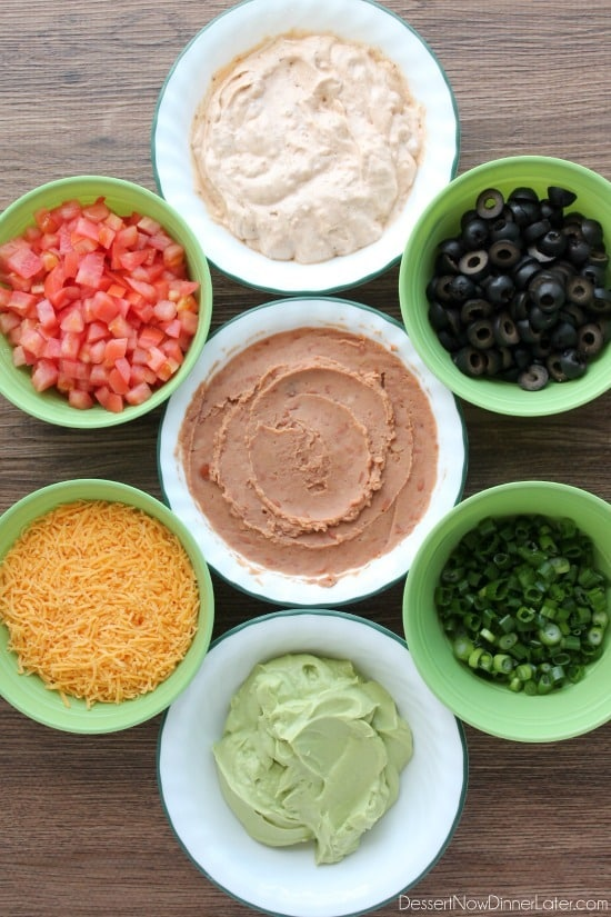 Seven Layer Dip is a classic party snack or football food. This version has a secret ingredient to make it a dip that is sure to get gobbled up by your guests!