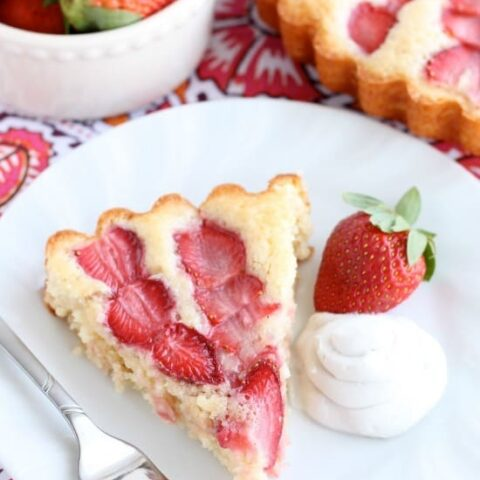 This Strawberry Cake is lightly sweet, layered with fresh sliced strawberries, and is served with a side of coconut whipped cream. A stunning and delicious dessert for any occasion or Valentine's Day.