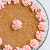 Almond Cherry Cookie Cake -Almond flavored sugar cookie cake with slivered almonds throughout and topped with cherry frosting. The best sugar cookie you will ever have!