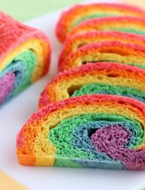 Rainbow Bread - Rhodes frozen dough is kneaded into 6 bright colors and rolled into a fun rainbow loaf (step-by-step photo instructions included). The perfect bread to eat with butter for dinner or use for breakfast french toast on St. Patrick's Day!