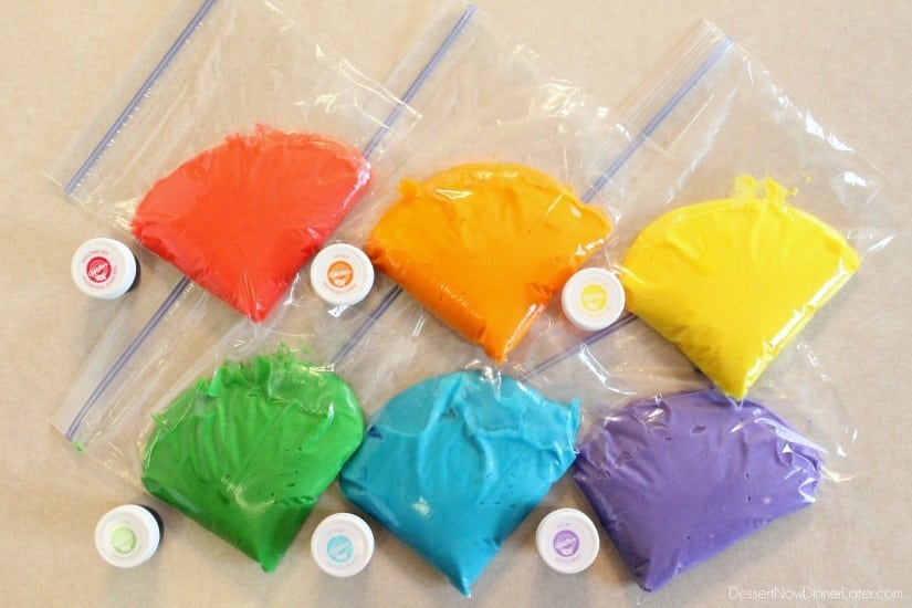 Rainbow Cupcake Batter in sandwich bags to pipe into cupcake liners.