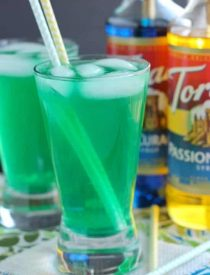 Xanadew - this FIIZ soda shop copycat drink recipe uses blue curacao and passion fruit syrups mixed into Mountain Dew for a fun green tropical mocktail!