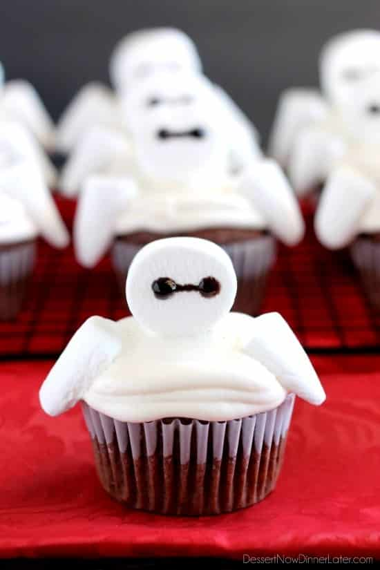 Big Hero 6 comes to life at home with these Baymax Cupcakes topped with marshmallow frosting and large marshmallows. {Step-by-Step Tutorial}