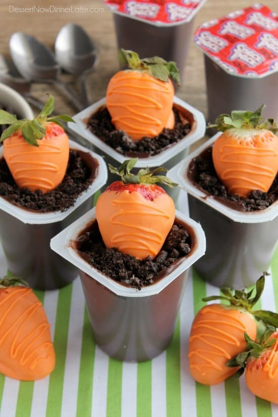 "Carrot Easter Pudding Cups - These fun pudding cups are perfect for Spring and Easter with an orange candy dipped strawberry ""carrot"" in crushed Oreo and chocolate pudding ""dirt."""