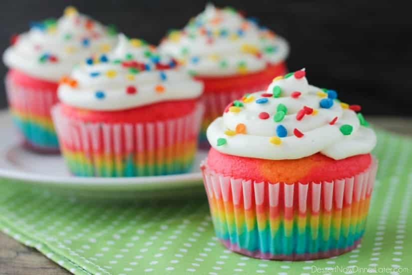 These Rainbow Cupcakes are made with a simple boxed white cake mix, colored, and layered to make a rainbow, with whipped cream cheese frosting on top! (Includes photo tutorial, and tips on baking cupcakes to perfection!)