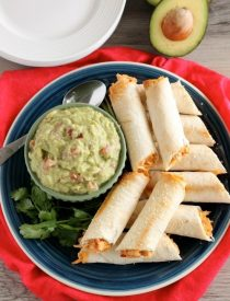 These Zesty Baked Chicken Taquitos are creamy and cheesy with a special ingredient to make them bold and zesty! A simple guacamole recipe is also included!