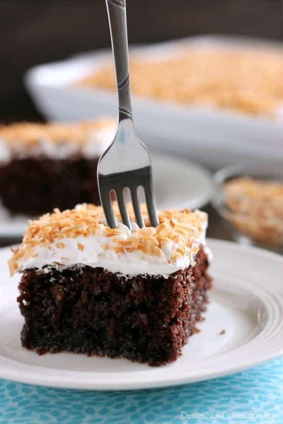 Coconut Cream Chocolate Poke Cake - an easy box cake makeover with cream of coconut, toasted coconut, and whipped cream!