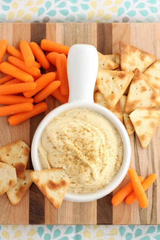 This Easy Garlic Hummus blends up in less than 1 minute for a smooth and creamy homemade hummus that goes perfectly with vegetables and crackers!