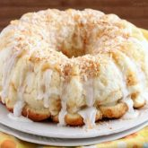 Pina Colada Monkey Bread - toasted coconut, crushed pineapple, and a secret ingredient combine together to make this sticky pull apart bread a tropical treat!