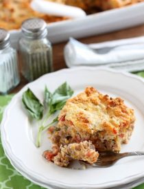 Savory Breakfast Bread Pudding has sausage, tomatoes, eggs, and herbs all in a cheesy bread pudding.