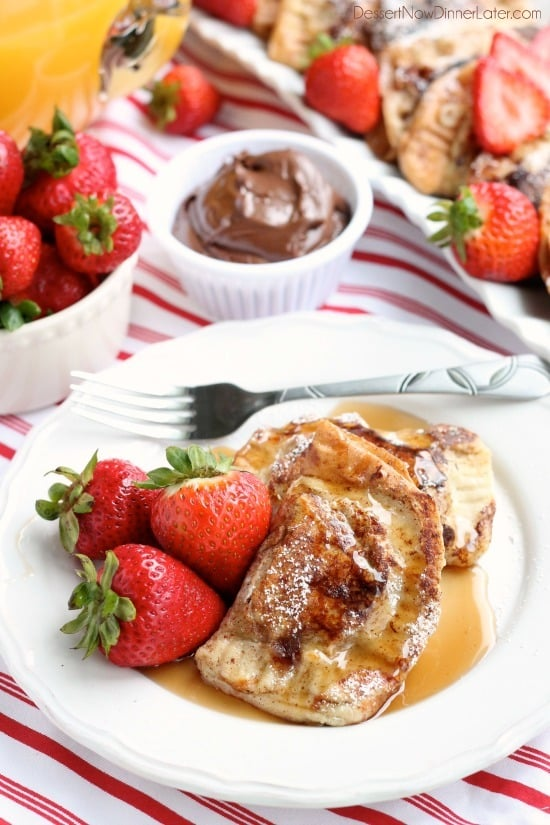 Fresh strawberries and Nutella are hidden inside this Stuffed French Toast recipe that's easy enough for the kids to help make!