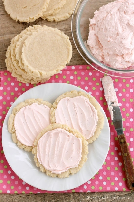 The ingredients list might surprise you with these scoop, press, and bake rustic-looking sugar cookies.  With a soft, sweet, melt-in-your-mouth cookie base, topped with a smooth and dreamy buttercream frosting -- these really are the BEST sugar cookies you will make at home!