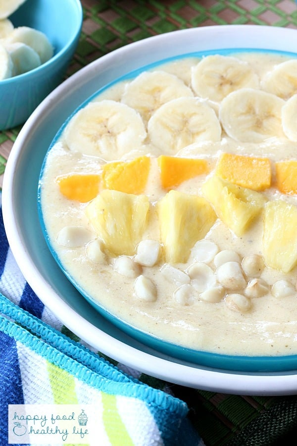 This tropical smoothie bowl is perfect for when you want the flavors of a smoothie but don't necessarily want to drink your breakfast. And the flavors will take you right to the beach!