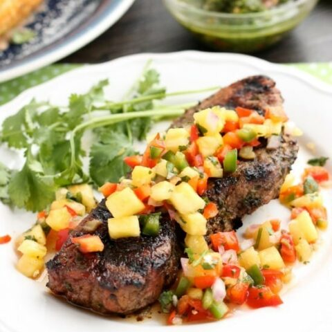 This restaurant-quality steak is marinated in an herbed chimichurri sauce, grilled to perfection, and topped with a spicy-sweet pineapple salsa.