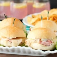 Cordon Bleu Sliders are made easy with deli meats, swiss cheese, honey dijon mayo, and freshly baked Rhodes® dinner roll slider buns!