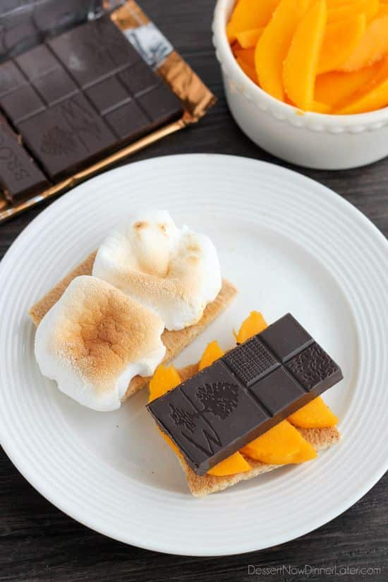 Mango S'mores - fresh mango slices, toasty marshmallows, and Brookside's Mango Coconut Crisp Chocolate Bar sandwiched between honey graham crackers.
