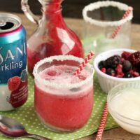 This Berry Coconut Spritzer is a refreshing and easy mocktail to mix up at any holiday party!
