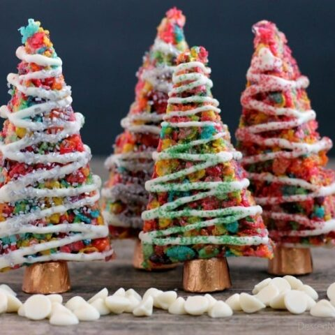 Fruity Pebbles cereal lights up these festive Krispie Treat Christmas Trees that are easy and fun to make for the holidays!