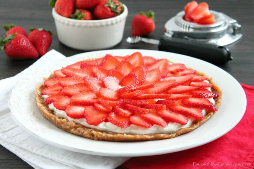 This Strawberry Greek Yogurt Tart is a delicious and healthy Valentine's Day dessert! It's even healthy enough to eat for breakfast too!