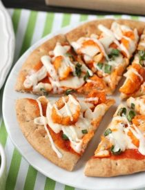 Farm Rich Boneless Buffalo Chicken Bites help make this flatbread pizza a quick and delicious game day snack!