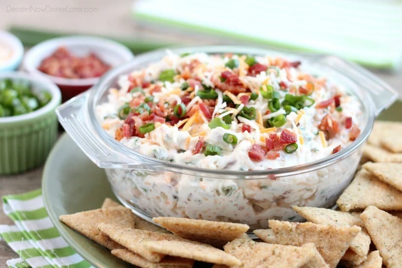 A loaded baked potato inspired this chip dip full of bacon, cheese, green onions, and ranch dressing mix. A delicious party dip or game day appetizer.