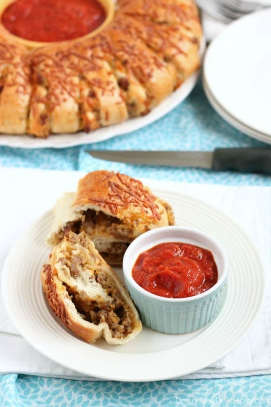 This Sausage Stromboli is a delicious hot sandwich that feeds a crowd! Make it for dinner or as an appetizer served with marinara for the big football game!