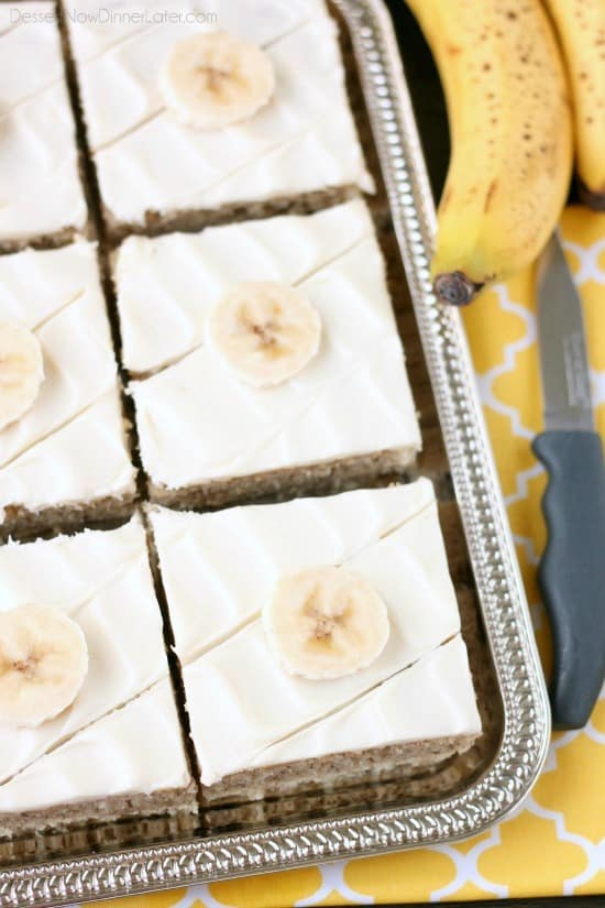 This is the BEST banana cake topped with the BEST cream cheese frosting! Perfect for picnics and potlucks, this banana sheet cake is a crowd pleaser! Everyone asks for the recipe!