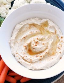This low carb cauliflower hummus is smooth, creamy, and full of savory garlic flavor!