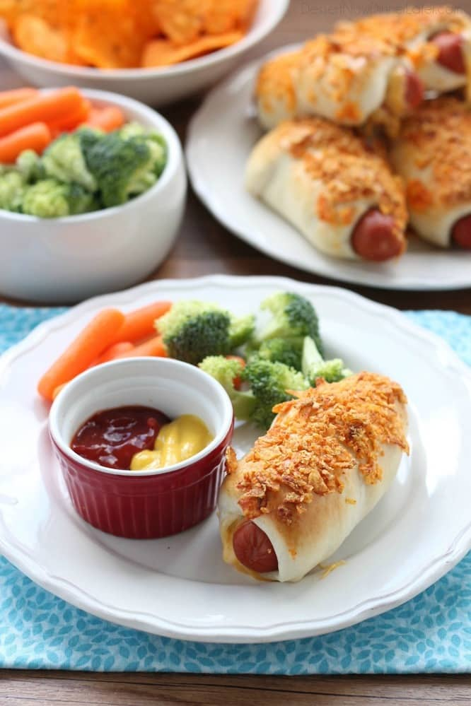 Frozen dough, nacho tortilla chips, and extra cheese transform ordinary pigs in a blanket into these extraordinary crunchy nacho dogs.