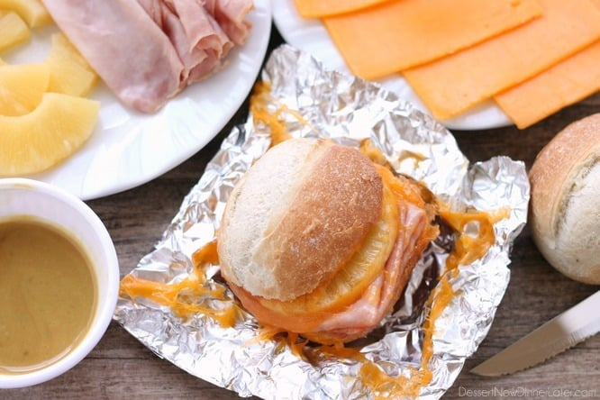 These Hot Ham and Pineapple Campfire Sandwiches are a delicious and easy tin foil recipe. Plus cleanup is a breeze! (You can even bake these in the oven too!)