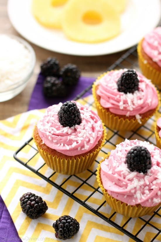 Blackberry Piña Colada Cupcakes - Moist coconut cupcakes with a sweet pineapple and rum filling topped with fresh blackberry frosting. A delicious drink inspired cupcake with a twist! (Cupcake Battles WINNER!)