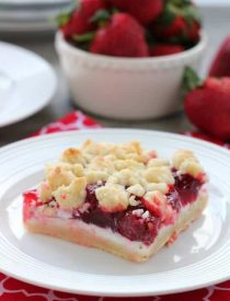 These strawberries and cream crumb bars are sweet and creamy with a buttery crumb crust and topping.