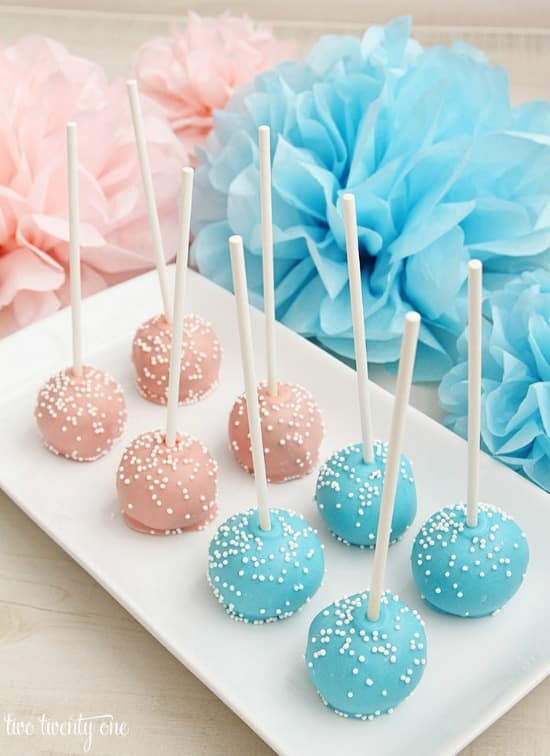 These PINK AND BLUE CAKE POPS are easy to serve at a baby shower and aren't that hard to make. Image from Two Twenty One.