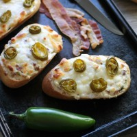 Jalapeno Popper Bread can double as a delicious appetizer or easy pizza dinner with bacon, cream cheese, and jalapeno slices for maximum flavor!