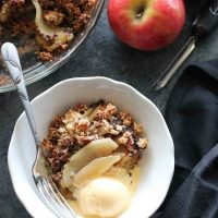This simple and delicious gluten-free apple crisp is lightly sweet, with a warm hint of cinnamon, and a crunchy nut topping!